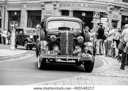Wroclaw- August 18: Old car on Motoclassic show in black and white, in Wroclaw, Poland on August 18, 2014. - stock photo