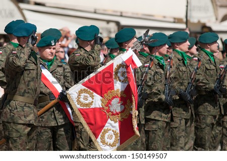 Wroclaw - August 15: Soldier salute with Polish coat of arms (Day of Polish Army) on 6 July 2013 in Wroclaw, Poland - stock photo