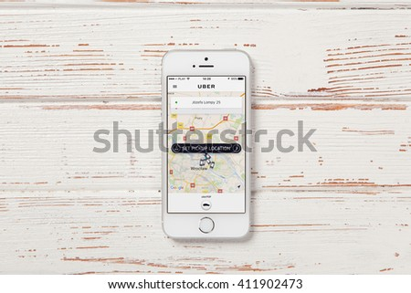 WROCLAW, POLAND - APRIL 12, 2016: Apple iPhone SE smartphone with Uber app on screen - stock photo