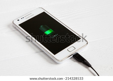 WROCLAW, POLAND - AUGUST 26, 2014: Photo of a Samsung Galaxy S2 Android smartphone - stock photo