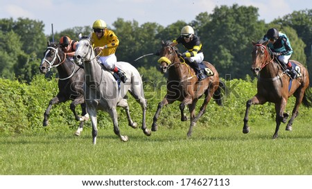 WROCLAW, POLAND - JUNE 23: Matej Rigo (first) on a horse Hortensja in the international race for the prize of the President of Wroclaw in a Racecourse Partynice on June 23,2013 in Wroclaw, Poland.  - stock photo