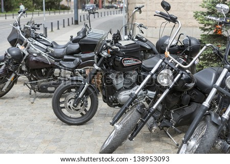 """WROCLAW, POLAND - MAY 18: View of Harley Davidson motorcycle parked in the city during """"Harley-Davidson Super Rally 2013"""" on 18, 2013 in Wroclaw, Poland. Europe's largest 5 day motorcycle event - stock photo"""