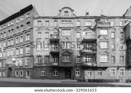 WROCLAW, POLAND - OCTOBER 17, 2015: Amazing WWII movie location / WW2 movie set photos for location scout in black and white in Wroclaw / Breslau Poland. Untouched brick buildings damaged by WW2 - stock photo