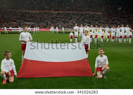 Wroclaw, Poland. 17th November, 2015. International Football friendly match: Poland v Czech Republic. Flag and team of Poland before match. - stock photo