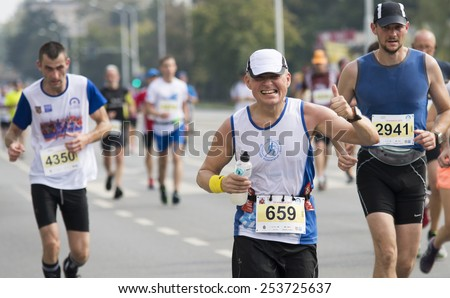 Wroclaw September 14: Group of runners in Wroclaw streets running during Wroclaw Marathon on September 14, 2014 in Wroclaw, Poland - stock photo