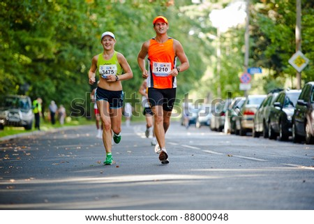 WROCLAW - SEPTEMBER 11: Wroclaw Marathon runners, September 11, 2011 in Wroclaw, Poland - stock photo