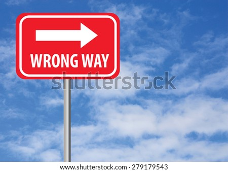 wrong way sign with arrow and sky background - stock photo