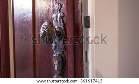 Wrought Iron Door handle and door lock - stock photo