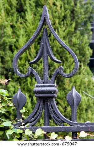 Wrought iron fence ornament - stock photo