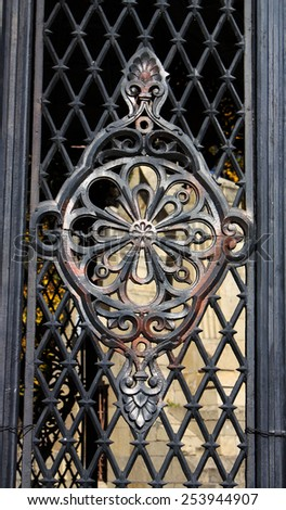 Wrought iron fence with decorative pattern. - stock photo