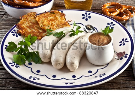 wurstel Weisswurst with sweet bavarian mustard and pretzels - stock photo