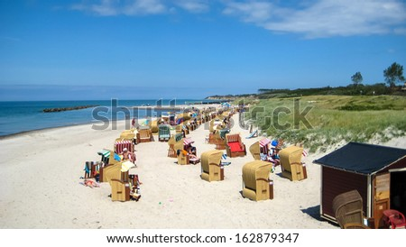 Wustrow beach with beach chairs, view from the pier - stock photo