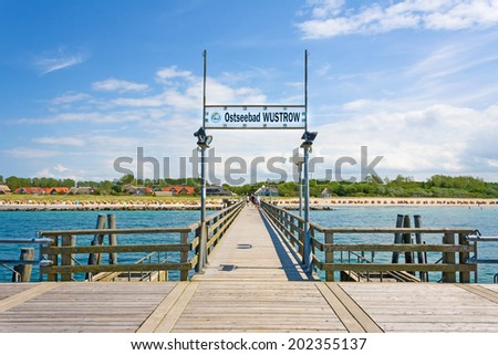 WUSTROW, GERMANY - JUNE 19, 2012: Pier of Wustrow. A famous tourist destination of the sea spa town. - stock photo