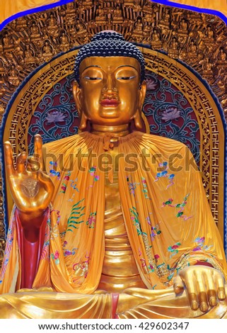 WUXI, CHINA - April 18, 2016: Buddha statue in the Ling Shan Buddha Palace, Ling Shan, Wuxi, Jiangshu Province, China - stock photo