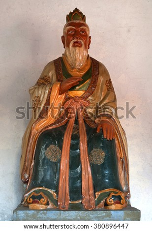 WUZHEN, SHANGHAI-DECEMBER 2, 2008: famous Confucius statue in the village. Wuzhen water village is Shanghai tourist attraction with more than 100000 visitors per year.  - stock photo