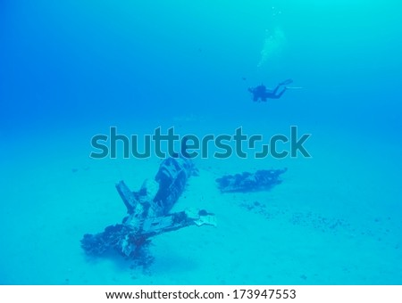 WW2 era Corsair airplane wreck and diver background.  - stock photo