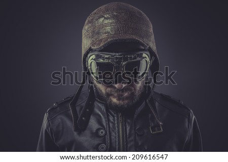 ww2 pilot dressed in vintage style leather cap and goggles - stock photo