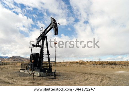 Wyoming Industrial Oil Pump Jack Fracking Crude Extraction Machine - stock photo