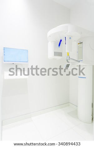 X-ray machine in the dental clinic in white color - stock photo