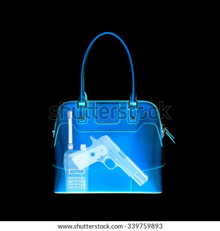 X-ray scan detects weapon in criminals briefcase - stock photo