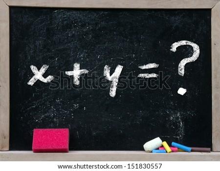 x+y=? writing chalkboard - stock photo