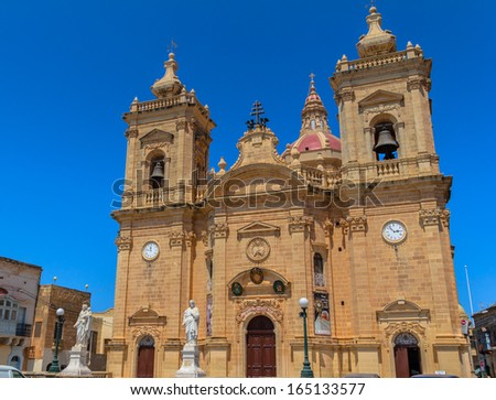Xaghra parish church with statues at its entrance in Gozo, Malta. - stock photo