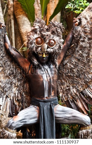 """XCARET, MEXICO - AUGUST 13: Shaman in the performance """"Mexico Espectacular"""", the most famous show in Mexico with more than 300 artists on stage on August 13, 2012 in Xcaret, Mayan Riviera, Mexico - stock photo"""