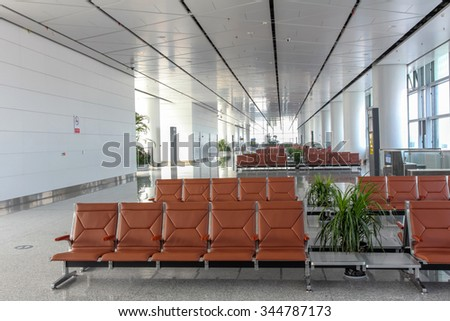 XI'AN, CHINA - SEP 17, 2015: Interior of Xi'an Xianyang International Airport. It is the main airport serving Xi'an, capital of China's Shaanxi Province. - stock photo