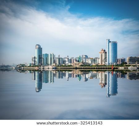 xiamen skyline with reflection, beautiful coastal city, China - stock photo