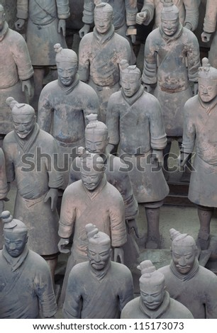 "XIAN,CHINA -APRIL 15 :The Terracotta Army or the ""Terra Cotta Warriors and Horses"" buried in the pits next to the Qin Shi Huang's tomb in 210-209 BC. April 15, 2010 in Xian of Shaanxi Province, China. - stock photo"