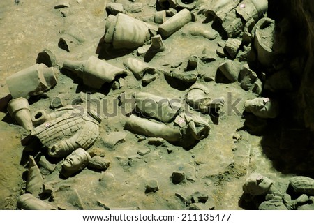 XIAN, CHINA - MAY 3, 2012: Collection of unrestored terracotta sculptures depicting the armies of the first emperor of China - stock photo