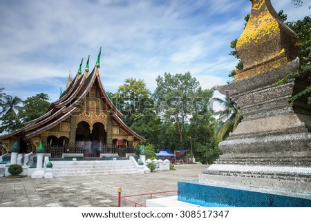 Xieng Thong Temple with blue sky and cloud flowing in Luang Prabang , Laos - stock photo