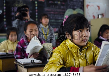 XINGTAI CITY, CHINA - APRIL 26, 2010: In the April 26, 2010, baixiang County schools organize teachers to observe lessons. Unidentified teachers and students are very attentive. - stock photo