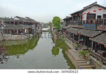 XITANG, SHANGHAI-APRIL 24, 2007: tourist relaxing in bars along the main canal.  Xitang water village is Shanghai tourist attraction with more than 1000000 visitors year. - stock photo