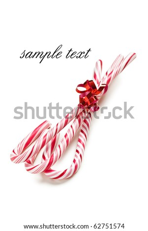 xmas background with stripy candy cane - stock photo