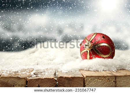 xmas ball of red and winter landscape  - stock photo