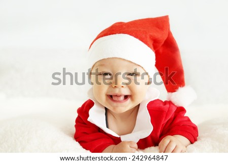 Xmas card with cute baby girl with Santa's hat - stock photo