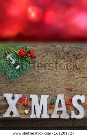 XMAS Christmas text with beautiful red Bokeh - stock photo