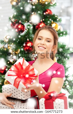 xmas, christmas, winter, holidays and happiness concept - happy woman with many gift boxes and christmas tree - stock photo