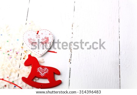 xmas composition Christmas card wooden toys on a white wooden background heart horse fir new year winter - stock photo