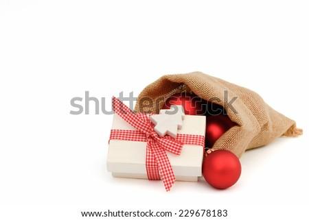 Xmas present in santa bag - stock photo