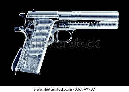 xray image of gun isolated on black background - stock photo