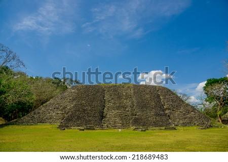 xunantunich maya site ruins in belize caribbean under blue sky - stock photo