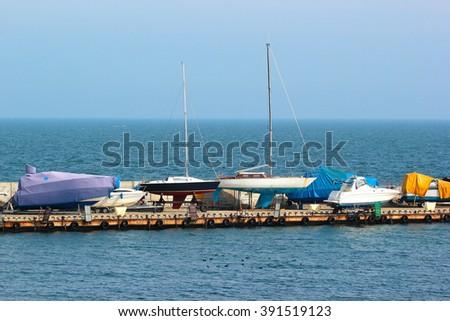 yacht ashore in a boatyard - stock photo
