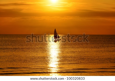 yacht at sunset in Cape May - stock photo