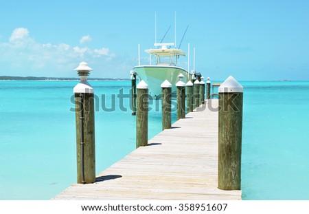 Yacht at the wooden jetty. Exuma, Bahamas - stock photo