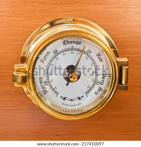 Yacht Barometer Close Up shot on wooden background - stock photo