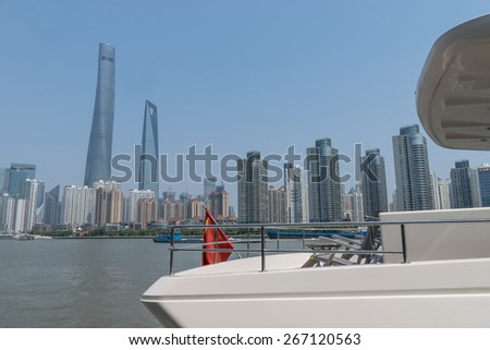 Yacht boat on huangpu river with lujiazui skyline - stock photo