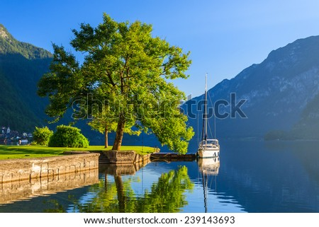 Yacht boat on lake in Hallstatt mountain village, Austria - stock photo