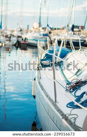 Yacht boat on ocean water with flare and outdoor lifestyle - stock photo
